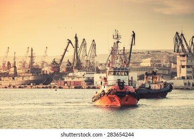 Tug boats are working in Varna harbor. Black Sea, Bulgaria. Vintage stylized photo with warm tonal correction photo filter, instagram old style