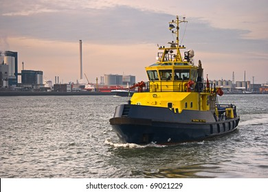 Tug on the river with industrial background