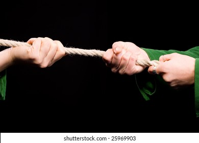 Tug of War cloese-up on hands. duel and challenge concept