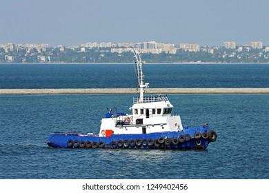 Tugboat in harbor quayside of Odessa, Ukraine