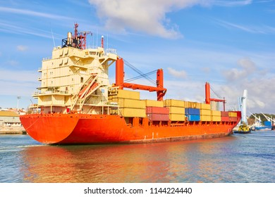 Tugboat pulls a large cargo ship to port. Transportation and logistics work