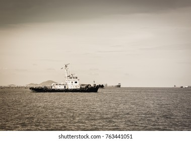 tugboat in the sea on vintage tone