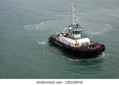 Tugboat in the sea. Upper side view.