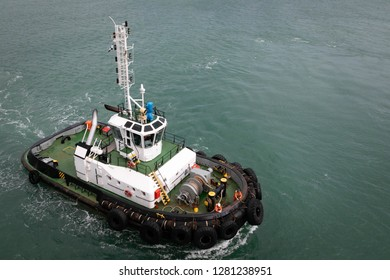 Tugboat in the sea. Upper view.