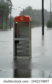 Tuggerah, NSW, Australia – March 20, 2021: Flooded phone booth on the Central Coast of NSW, Australia
