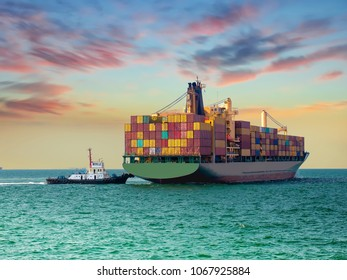 A tugs boat assist container vessel to be berthing at industrail port of thailand.