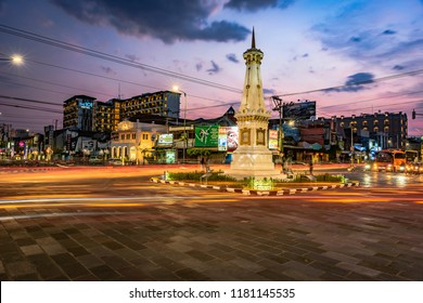 Tugu Jogja or Yogyakarta Monument in blue hours with vehicle traffic light trail blue hours: Yogyakarta, Indonesia - 16 September 2018