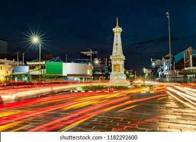 Tugu Jogja or Yogyakarta Monument, Indonesia taken in blue hours with vehicle traffic light trail blue hours