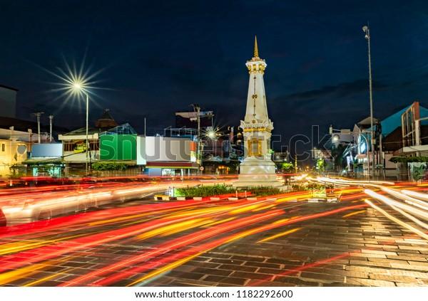 Tugu Jogja or Yogyakarta Monument, Indonesia taken in blue hours with vehicle traffic light trail blue hours