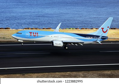 TUI Boeing 737. The Commercial jet aeroplane started the landing gear system for landing.. Airport Funchal, Madeira, Portugal. Atlantic Ocean. August 12, 2018.