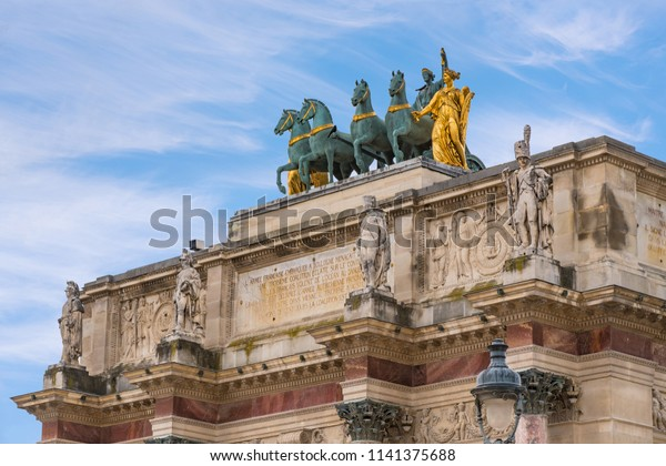 Tuileries Garden Statues over the Carrousel Arch of Triumph, Paris, France, copy of the Saint Mark horses. It is a public garden located between Louvre and Concorde Place. It was opened in 1667.