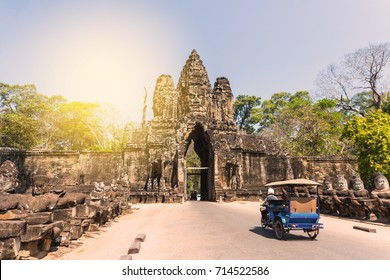 Tuk tuk and angkor thom gate in siem reap cambodia , toned and filter