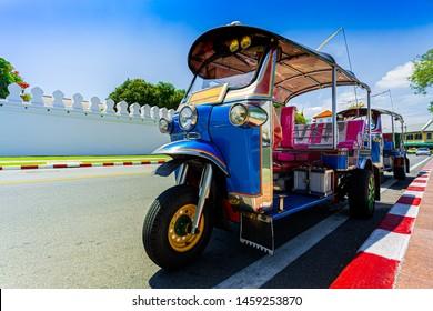 Tuk Tuk is parking in front of Wat Phra Kaeo or Grand Palace, Bangkok, Thailand,Bangkok, Asia, Thailand, Jinrikisha, Architecture,Greeting, City Street, Dating, Road, Smiling