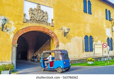 The tuk tuk riding to the exit of Galle Fort through the Old Gate, Sri Lanka.