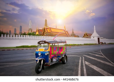 Tuk-tuk for passenger cars To go sightseeing around the Grand Palace in Bangkok with sunset sky background