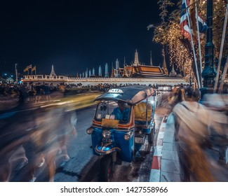 Tuktuk Thailand,Traditional taxi at Temple of the Emerald Buddha,people in motion blur