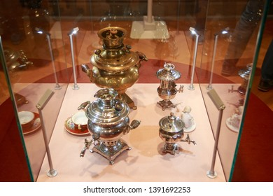 Tula city, Russia - May 2019: beautiful shining samovars are in the showcase in the museum of samovars in Tula. The city is city of masters and very famous by its samovars, genuine masterpieces.