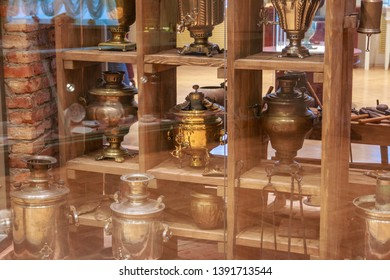 Tula city, Russia - May 2019: beautiful samovars are in the showcase in the museum of samovars in Tula. The city is city of masters and very famous by its samovars, genuine masterpieces.