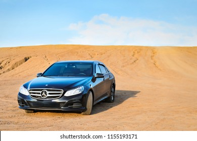Tula region, Russia-July 14, 2018. Mercedes-Benz stands on the sand against the blue sky
