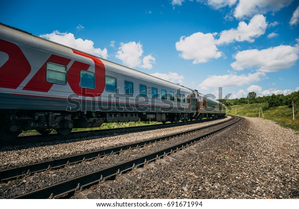 Tula, Russia - August 06, 2017: The train travels by rail on a sunny day, the train with the logo of RZD - Russian Railway