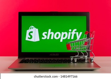 Tula, Russia - AUGUST 18, 2019: Shopify logo displayed on a modern laptop on desk. Focus on cart.