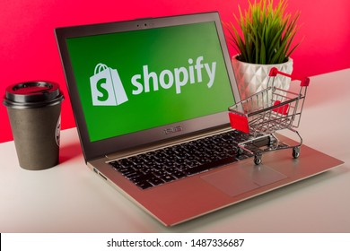 Tula, Russia - AUGUST 18, 2019: Shopify logo displayed on a modern laptop on desk with cart.