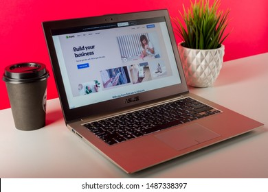 Tula, Russia - AUGUST 18, 2019: Shopify web page displayed on a modern laptop on desk