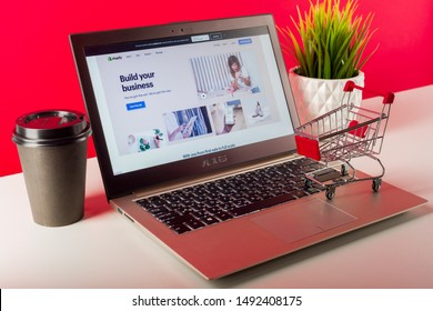Tula, Russia - AUGUST 18, 2019: Shopify web page displayed on a modern laptop on desk with cart