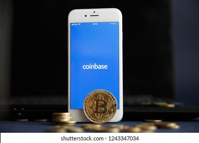 Tula, Russia - August 28, 2018 Bitcoin BTC on stack of cryptocurrencies with Coinbase logo in background. The cryptocurrency coin is golden and in focus.