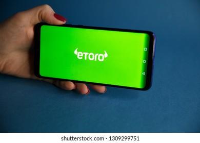 Tula, Russia - JANUARY 29, 2019: eToro logo displayed on a modern