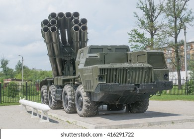 """TULA, RUSSIA - JUNE 4, 2015 : MLRS 9K58 """"Smerch"""" - Soviet and Russian multiple launch rocket systems fire at the entrance of the Tula NPO """"Splav"""" on a pedestal"""