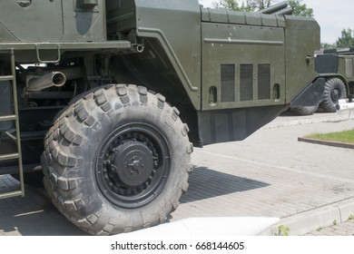 """TULA, RUSSIA - JUNE 4, 2015 : MLRS 9K58 """"Smerch"""" - Soviet and Russian multiple launch rocket systems fire at the entrance of the Tula NPO """"Splav"""", a view of the wheel and the cab"""