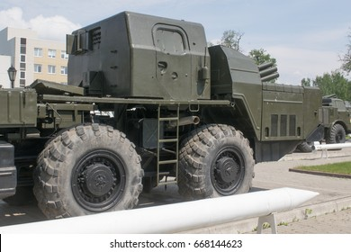"""TULA, RUSSIA - JUNE 4, 2015 : MLRS 9K58 """"Smerch"""" - Soviet and Russian multiple launch rocket systems fire at the entrance of the Tula NPO """"Splav"""" , a view of the cabin and wheels"""