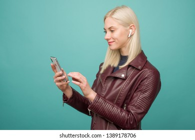 Tula, Russia - May 1, 2019: Happy woman listening music Apple AirPods wireless - Image