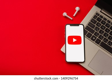Tula, Russia - May 24,2019: Apple iPhone X with Youtube logo on the screen on red background. - Image