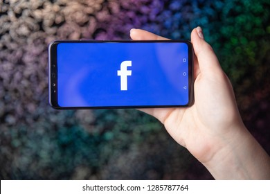 Tula, Russia - November 28, 2018: Facebook social media app logo on log-in, sign-up registration page on mobile app screen on smart devices in business person's hand at