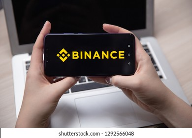 Tula, Russia - November 28, 2018: Apple iPhone and Binance logo and bitcoin, ethereum and dollars. is a cryptocurrency exchange.
