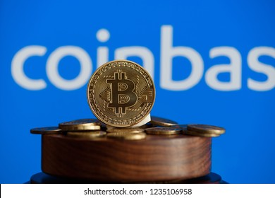 Tula, Russia - October 31, 2018: - Bitcoin BTC on stack of cryptocurrencies with Coinbase logo in background. The cryptocurrency coin is golden and in focus.