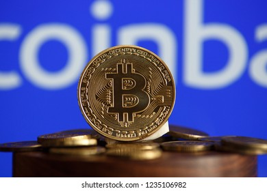 Tula, Russia - October 31, 2018: - Bitcoin BTC on stack of cryptocurrencies with Coinbase logo in background. The cryptocurrency coin is golden and in focus. Copenhagen