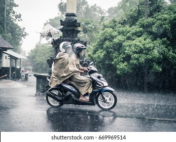 Tulamben, Bali - Circa March 2017 - Scooters in the rain