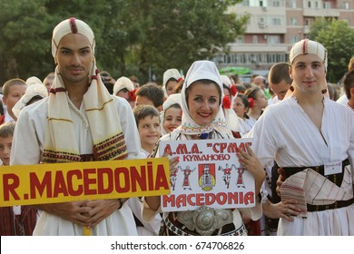 TULCEA, ROMANIA - AUGUST 08: Macedonian group of dancers in traditional costumes at the International Folklore Festival for Children and Youth Golden Fish on August 08, 2014 in Tulcea, Romania.