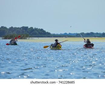 TULCEA, ROMANIA - AUGUST 13, 2017: Canoe tourists in the Danube delta, Romania