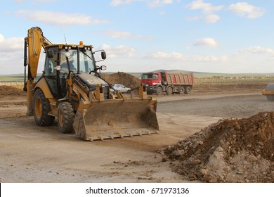TULCEA, ROMANIA - NOVEMBER 08: Heavy construction equipment working on a runway as part of the Danube Delta international airport expansion plan on November 08, 2015 in Tulcea, Romania.