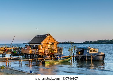 TULCEA, ROMANIA - October 1: Tulcea on October 1, 2015 in Romania. Fisherman's House, the old dock and the boat on the lake.