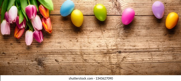 Tulip flower and easter egg on wood background