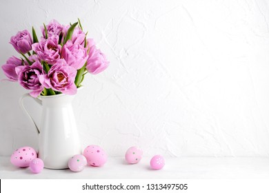 Tulip flower and easter eggs on white background