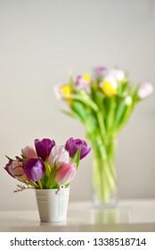 Tulip flowers in vase on white table
