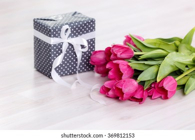 Tulips and boxes with gifts. On March 8, International Women's Day, Mother's Day