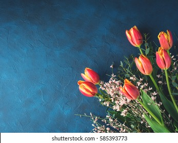 Tulips bunch bouquet on dark background invitation. Valentine mother woman day romantic greeting card with red flowers