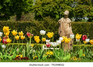Tulips in front of antique statue on spa island in Piestany (SLOVAKIA)